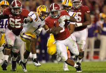 TUSCALOOSA, AL - NOVEMBER 05:  Trent Richardson #3 of the Alabama Crimson Tide is tackled by Eric Reid #1 of the LSU Tigers during their game at Bryant-Denny Stadium on November 5, 2011 in Tuscaloosa, Alabama.  (Photo by Streeter Lecka/Getty Images)