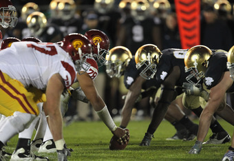 SOUTH BEND, IN - OCTOBER 22:  Members of the Notre Dame Fighting Irish defense line up against the offense of the University of Southern California Trojans at Notre Dame Stadium on October 22, 2011 in South Bend, Indiana. USC defeated Notre Dame 31-17.  (