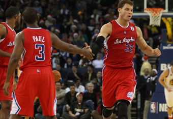 OAKLAND, CA - DECEMBER 25:  Blake Griffin #32 of the Los Angeles Clippers celebrates with Chris Paul #3 against Golden State Warriors during the season opener at Oracle Arena on December 25, 2011 in Oakland, California.  NOTE TO USER: User expressly ackno