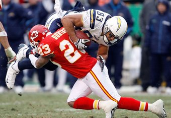 KANSAS CITY, MO - DECEMBER 14:  Vincent Jackson #83 of the San Diego Chargers is hit by Patrick Surtain #23 of the Kansas City Chiefs during the game on December 14, 2008 at Arrowhead Stadium in Kansas City, Missouri.  (Photo by Harry How/Getty Images)