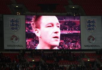 LONDON, ENGLAND - NOVEMBER 15:  John Terry of England appears on the video screen ahead of the international friendly match between England and Sweden at Wembley Stadium on November 15, 2011 in London, England.  (Photo by Julian Finney/Getty Images)