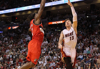 MIAMI, FL - MARCH 08:  Mike Miller #13 of the Miami Heat drives on  Gerald Wallace #3 of the Portland Trail Blazers during a game at American Airlines Arena on March 8, 2011 in Miami, Florida. NOTE TO USER: User expressly acknowledges and agrees that, by