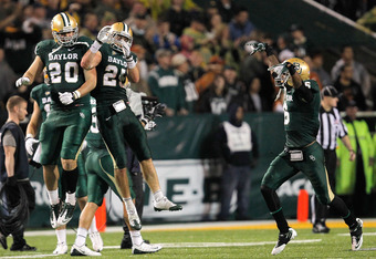 WACO, TX - DECEMBER 03: Jerod Monk #20 of the Baylor Bears celebrates with teammates Sam Holl #25 and Ahmad Dixon #6 during a game against the Texas Longhorns at Floyd Casey Stadium on December 3, 2011 in Waco, Texas. The Baylor Bears defeated the Texas L