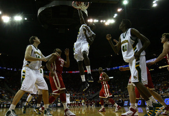 KANSAS CITY, MO - MARCH 09:  Quincy Acy #4 of the Baylor Bears dunks the ball against the Oklahoma Sooners during their game in the first round of the 2011 Phillips 66 Big 12 Men's Basketball Tournament at Sprint Center on March 9, 2011 in Kansas City, Mi