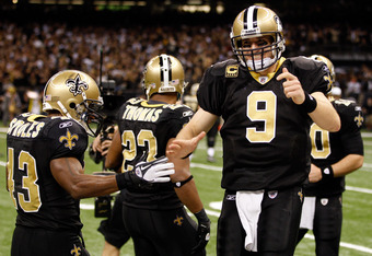 NEW ORLEANS, LA - DECEMBER 26:  (R) Quarterback Drew Brees #9 of the New Orleans Saints celebrates throwing a 24-yard third quarter touchdown pass with running back Darren Sproles #43 against the Atlanta Falcons at the Mercedes-Benz Superdome on December