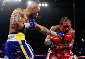 NEW YORK, NY - DECEMBER 03:  Miguel Cotto (L) of Puerto Rico connects with a left handed punch against Antonio Margarito of Mexico during the WBA World Junior Middleweight Title fight at Madison Square Garden on December 3, 2011 in New York City.  (Photo