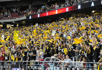GLENDALE, AZ - OCTOBER 23:  Visiting Pittsburgh Steelers fans wave Terrible Towels during the game against the Arizona Cardinals at University of Phoenix Stadium on October 23, 2011 in Glendale, Arizona.  (Photo by Karl Walter/Getty Images)