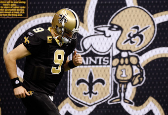 NEW ORLEANS, LA - DECEMBER 26:  Quarterback Drew Brees #9 of the New Orleans Saints warms-up before taking on the Atlanta Falcons at Mercedes-Benz Superdome on December 26, 2011 in New Orleans, Louisiana.  (Photo by Chris Graythen/Getty Images)
