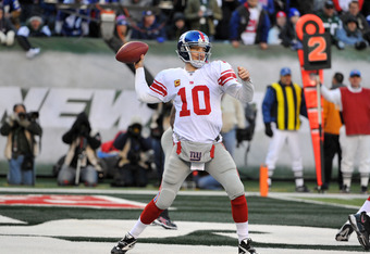 EAST RUTHERFORD, NJ - DECEMBER 24: Eli Manning #10 of the New York Giants drops back to pass during the first half against the New York Jets on December 24, 2011 at MetLife Stadium in East Rutherford, New Jersey. (Photo by Christopher Pasatieri/Getty Imag