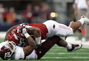 ARLINGTON, TX - OCTOBER 01:  Ronald Watkins #30 of the Arkansas Razorbacks is tackled by Charlie Thomas #9 of the Texas A&M Aggies at Cowboys Stadium on October 1, 2011 in Arlington, Texas.  (Photo by Ronald Martinez/Getty Images)