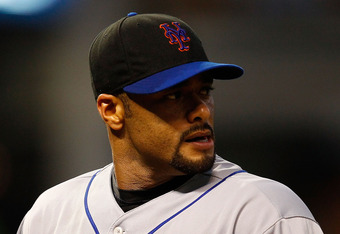 CLEVELAND - JUNE 15:  Johan Santana #57 of the New York Mets walks back to the dugout during the game against the Cleveland Indians on June 15, 2010 at Progressive Field in Cleveland, Ohio.  (Photo by Jared Wickerham/Getty Images)