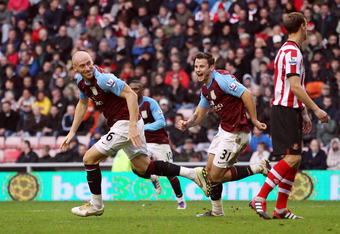 SUNDERLAND, ENGLAND - OCTOBER 29:  James Collins of Aston Villa (L) celebrates his goal during the Barclays Premier League match between Sunderland and Aston Villa at Stadium of Light on October 29, 2011 in Sunderland, England. (Photo by Ian MacNicol/Gett