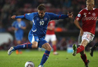 AALBORG, DENMARK - JUNE 18: Gylfi Sigurdsson (L) of Iceland shoots as Nicolai Boilesen (R) closes in during the UEFA European Under-21 Championship Group A match between Iceland and Denmark at the Aalborg Stadium on June 18, 2011 in Aalborg, Denmark.  (Ph