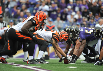 BALTIMORE - NOVEMBER 20:  Mike McGlynn #66 of the Cincinnati Bengals snaps the ball against the Baltimore Ravens at M&T Bank Stadium on November 20, 2011 in Baltimore, Maryland. The Ravens defeated the Bengals 31-24. (Photo by Larry French/Getty Images)
