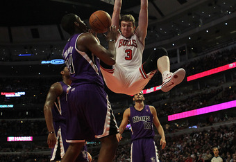 CHICAGO, IL - MARCH 21: Omer Asik #3 of the Chicago Bulls dunks the ball over Jason Thompson #34 of the Sacramento Kings at the United Center on March 21, 2011 in Chicago, Illinois. The Bulls defeated the Kings 132-92. NOTE TO USER: User expressly acknowl