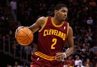 CLEVELAND, OH - DECEMBER 26:  Kyrie Irving #2 of the Cleveland Cavaliers brings the ball up court against the Toronto Raptors during the season opener at Quicken Loans Arena on December 26, 2011 in Cleveland, Ohio. NOTE TO USER: User expressly acknowledge