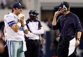 ARLINGTON, TX - DECEMBER 24:  Quarterback Tony Romo #9 of the Dallas Cowboys stands on the sidelines with head coach Jason Garrett as the Dallas Cowboys take on the Philadelphia Eagles at Cowboys Stadium on December 24, 2011 in Arlington, Texas. Romo hurt