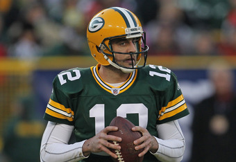 GREEN BAY, WI - DECEMBER 11:  Aaron Rodgers  #12 of the Green Bay Packers looks for a receiver against the Oakland Raiders at Lambeau Field on December 11, 2011 in Green Bay, Wisconsin. The Packers defeated the Raiders 46-16.  (Photo by Jonathan Daniel/Ge