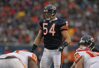 CHICAGO, IL - DECEMBER 04:  Brian Urlacher #54 of the Chicago Bears looks over an offensive alignment against the Kansas City Chiefs at Soldier Field on December 4, 2011 in Chicago, Illinois. The Chiefs defeated the Bears 10-3.  (Photo by Jonathan Daniel/