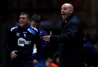 BLACKBURN, ENGLAND - DECEMBER 20:  Bolton Wanderers Manager Owen Coyle (L) and Blackburn Rovers Manager Steve Kean issue instructions during the Barclays Premier League match between Blackburn Rovers and Bolton Wanderers at Ewood Park on December 20, 2011