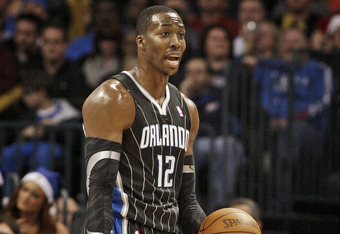 OKLAHOMA CITY, OK - DECEMBER 25:  Dwight Howard #12 of the Orlando Magic questions a call during the NBA season opening game against the Oklahoma City Thunder December 25, 2011 at the Chesapeake Energy Arena in Oklahoma City, Oklahoma.  Oklahoma City defe