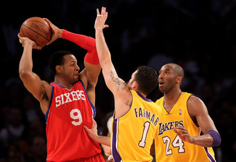 LOS ANGELES, CA - FEBRUARY 26:  Andre Iguodala #9 of the Philadelphia 76ers is defended by Jordan Farmar #1 and Kobe Bryant #24 of the Los Angeles Lakers in the second half at Staples Center on February 26, 2010 in Los Angeles, California. The Lakers defe