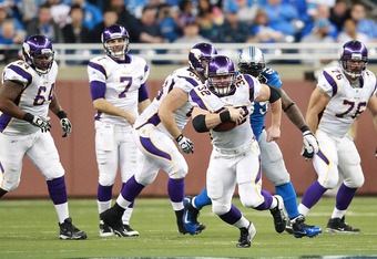 DETROIT, MI - DECEMBER 11:  Toby Gerhart #32 of the Minnesota Vikings runs for a first down during the game against the Detroit Lions at Ford Field on December 11, 2011 in Detroit, Michigan. The Lions defeated the Vikings 34-28.  (Photo by Leon Halip/Gett