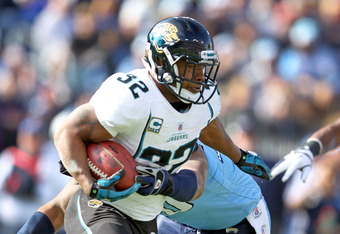 NASHVILLE, TN - DECEMBER 24:  Maurice Jones-Drew of the Jacksonville Jaguars runs with the ball during the NFL game against the Tennessee Titans at LP Field on December 24, 2011 in Nashville, Tennessee.  (Photo by Andy Lyons/Getty Images)