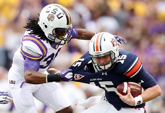 BATON ROUGE, LA - OCTOBER 22:  Derrick Bryant #36 of the LSU Tigers sacks quarterback Clint Moseley #15 of the Auburn Tigers during the game at Tiger Stadium on October 22, 2011 in Baton Rouge, Louisiana.  (Photo by Jamie Squire/Getty Images)