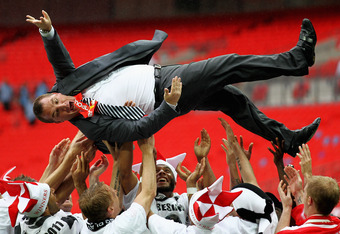 LONDON, ENGLAND - MAY 30:  Swansea Manager, Brendan Rodgers is thrown in the air by his players after winning the npower Championship Playoff Final between Reading and Swansea City at Wembley Stadium on May 30, 2011 in London, England.  (Photo by Dean Mou