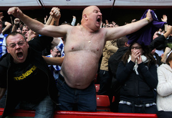 SHEFFIELD, ENGLAND - OCTOBER 16:  Fans celebrate after Gary Madine of Sheffield Wednesday scores his teams second goal during the npower League One match between Sheffield United and Sheffield Wednesday at Bramall Lane on October 16, 2011 in Sheffield, En