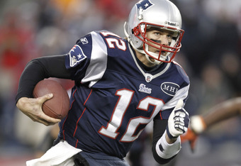 FOXBORO, MA - DECEMBER 24: Tom Brady #12 of the New England Patriots runs with the ball against the Miami Dolphins during the second half of New England's 27-24 win at Gillette Stadium on December 24, 2011 in Foxboro, Massachusetts.  (Photo by Winslow Tow