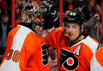 PHILADELPHIA, PA - DECEMBER 08:  Goalie Ilya Bryzgalov #30 and Danny Briere #48 of the Philadelphia Flyers celebrate the Flyers win after an NHL hockey game against the Pittsburgh Penguis at Wells Fargo Center on December 8, 2011 in Philadelphia, Pennsylv