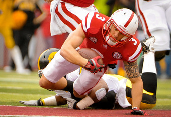 LINCOLN, NE - NOVEMBER 25: Quarterback Taylor Martinez #3 of the Nebraska Cornhuskers dives for extra yardage during their game against the Iowa Hawkeyes at Memorial Stadium November 25, 2011 in Lincoln, Nebraska. Nebraska defeated Iowa 20-7. (Photo by Er