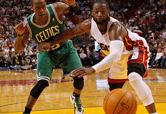 MIAMI, FL - DECEMBER 27:  Dwyane Wade #3 of the Miami Heat and Rajon Rondo #9 of the Boston Celtics fight for a loose ball during a game  at American Airlines Arena on December 27, 2011 in Miami, Florida. NOTE TO USER: User expressly acknowledges and agre