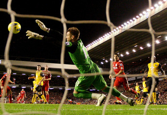LIVERPOOL, ENGLAND - DECEMBER 26:  Mark Bunn of Blackburn saves from Andy Carroll of Liverpool during the Barclays Premier League match between Liverpool and Blackburn Rovers at Anfield on December 26, 2011 in Liverpool, England.  (Photo by Scott Heavey/G