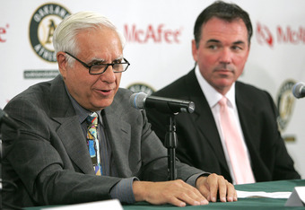 OAKLAND, CA - APRIL 1:  (L-R)  Lewis Wolff, new co-owner and managing partner of the Oakland Athletics, speaks during a news conference as Athletics Vice President and General Manager Billy Beane looks on April 1, 2005 in Oakland, California. Major League
