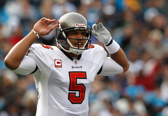 CHARLOTTE, NC - DECEMBER 24:  Josh Freeman #5 of the Tampa Bay Buccaneers calls a play during their game against the Carolina Panthers at Bank of America Stadium on December 24, 2011 in Charlotte, North Carolina.  (Photo by Streeter Lecka/Getty Images)