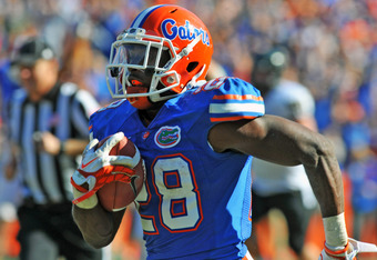 GAINESVILLE, FL -  NOVEMBER 5:  Running back Jeff Demps #28 of the Florida Gators runs for a 52-yard touchdown against the Vanderbilt Commodores November 5, 2011 at Ben Hill Griffin Stadium in Gainesville, Florida.  Demps scored in the second quarter. (Ph