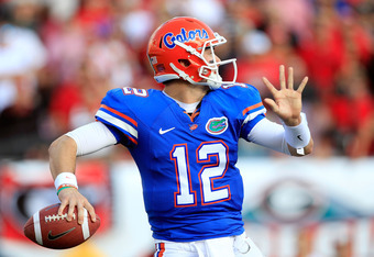 JACKSONVILLE, FL - OCTOBER 29:  John Brantley #12 of the Florida Gators attempts a pass during the game against the Georgia Bulldogs  at EverBank Field on October 29, 2011 in Jacksonville, Florida.  (Photo by Sam Greenwood/Getty Images)