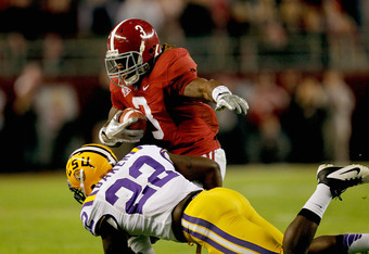 TUSCALOOSA, AL - NOVEMBER 05:  Trent Richardson #3 of the Alabama Crimson Tide makes a catch over Ryan Baker #22 of the LSU Tigers during the first half of the game at Bryant-Denny Stadium on November 5, 2011 in Tuscaloosa, Alabama.  (Photo by Streeter Le
