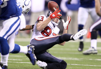 INDIANAPOLIS, IN - DECEMBER 22:  Kevin Walter #83 of the Houston Texans fumbles the ball during the NFL against the Indianapolis Colts at Lucas Oil Stadium on December 22, 2011 in Indianapolis, Indiana.  (Photo by Andy Lyons/Getty Images)