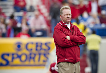 LITTLE ROCK, AR - NOVEMBER 19:   Head Coach Bobby Petrino and the Arkansas Razorbacks watches his team warm up before a game against the Mississippi State Bulldogs at War Memorial Stadium on November 19, 2011 in Little Rock, Arkansas. The Razorbacks defea