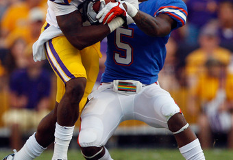 BATON ROUGE, LA - OCTOBER 08:  Kadron Boone #86 of the Louisiana State University Tigers is tackled by Marcus Roberson #5 of the Florida Gators at Tiger Stadium on October 8, 2011 in Baton Rouge, Louisiana.  (Photo by Chris Graythen/Getty Images)