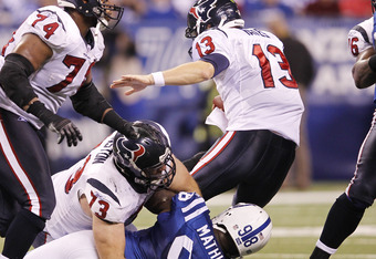 INDIANAPOLIS, IN - DECEMBER 22: Robert Mathis #98 of the Indianapolis Colts sacks T.J. Yates #13 of the Houston Texans at Lucas Oil Stadium on December 22, 2011 in Indianapolis, Indiana. The Colts defeated the Texans 19-16. (Photo by Joe Robbins/Getty Ima