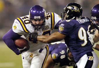 BALTIMORE - DECEMBER 25:  Jim Kleinsasser #40 of the Minnesota Vikings runs into Adalius Thomas #96 of the Baltimore Ravens during the second quarter on December 25, 2005 M&T Bank Stadium in Baltimore, Maryland. The Ravens won 30-23.  (Photo by Nick Wass/