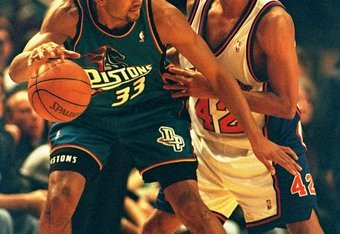 16 Dec 1997:  Grant Hill of the Detroit Pistons fends off Chris Mills of the New York Knicks in a match between the Detroit Pistons v New York Knicks in the NBA played at Madison Square Garden, Manhattan, New York, USA. The New York Knicks won the match83