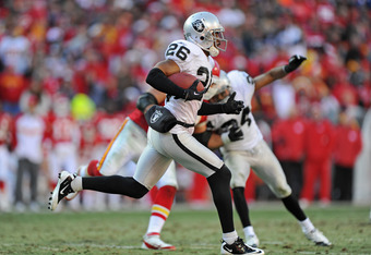 KANSAS CITY, MO - DECEMBER 24:  Defensive back Stanford Routt #26 of the Oakland Raiders returns an interception against the Kansas City Chiefs during the second half on December 24, 2011 at Arrowhead Stadium in Kansas City, Missouri.  Oakland defeated Ka