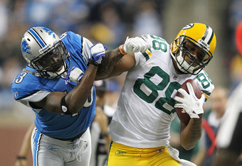DETROIT, MI - NOVEMBER 24: Jermichael Finley #88 of the Green Bay Packers catches a pass for a first down as Chris Harris #43 of the Green Bay Packers atempts to make the tackle during the third quarter of the game at Ford Field on November 24, 2011 in De