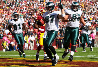 LANDOVER, MD - OCTOBER 16: Tight end Brent Celek #87 of the Philadelphia Eagles scores a touchdown in the first quarter against the Washington Redskins during first half action at FedEx Field on October 16, 2011 in Landover, Maryland.  (Photo by Win McNam